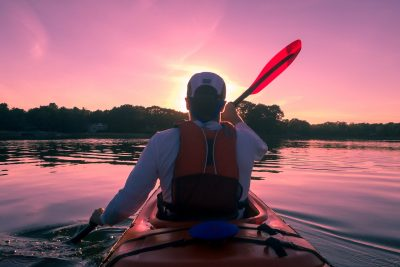 man kayaking at night