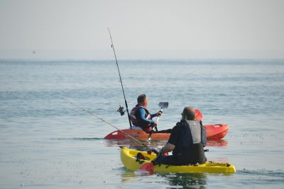 men in fishing kayaks